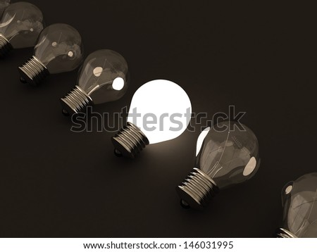 One individual glowing light bulb in others group - stock photo