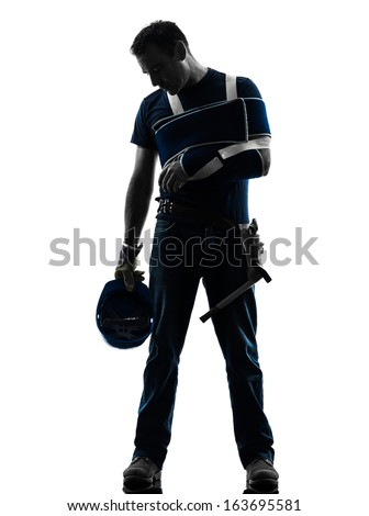 one injured manual worker man with injury brace despair in silhouette on white background - stock photo
