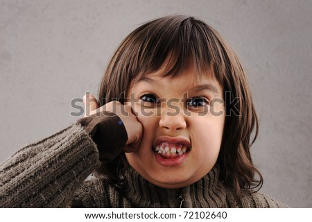 One kid - many faces, series of clever schoolboy 6-7 years old with facial expressions - stock photo