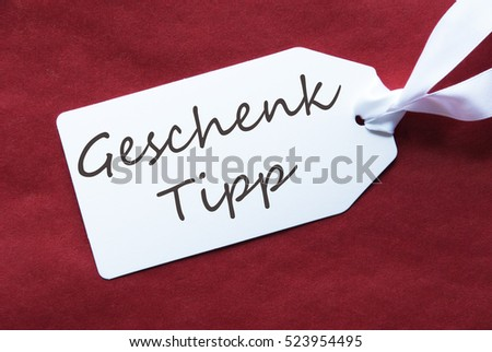One Label On Red Background, Geschenk Tipp Means Gift Tip