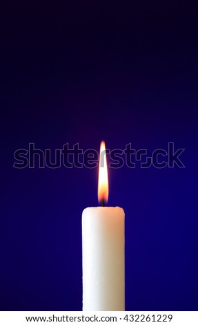 One lighting candle on nice dark background with free space - stock photo