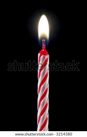 One lit birthday candle isolated over black. - stock photo
