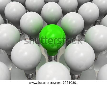 One lit light bulb amongst other broken light bulbs - stock photo