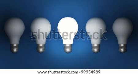 One lit light bulb amongst other broken light bulbs