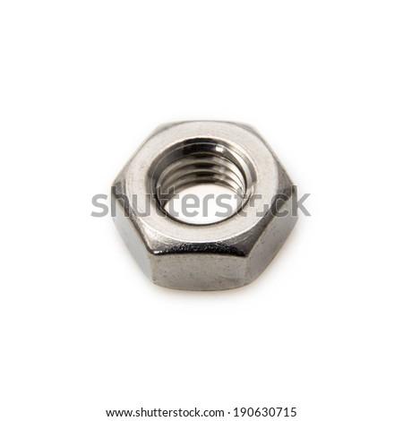 One macro metallic nut on white background - stock photo