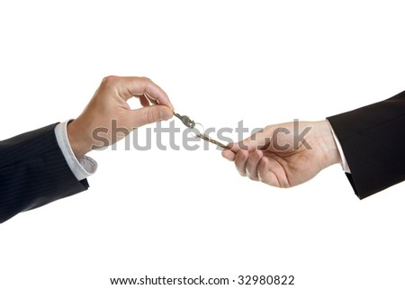 One male hand give another male hand keys - stock photo