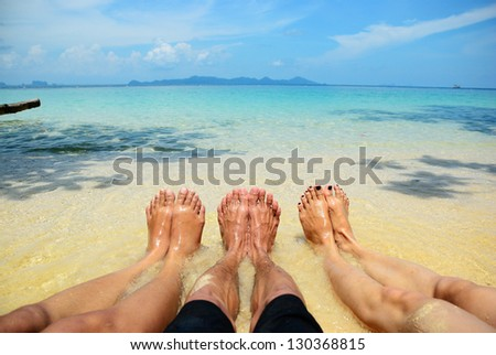 One man and two girl feel free on the beach - stock photo