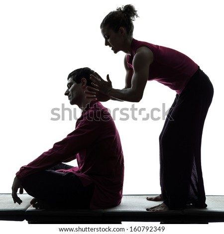 one man and woman performing thai massage in silhouette studio on white background