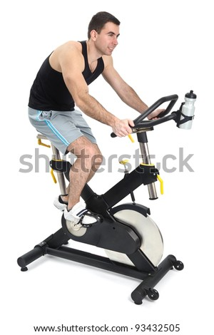 one man doing indoor biking exercise, on white background