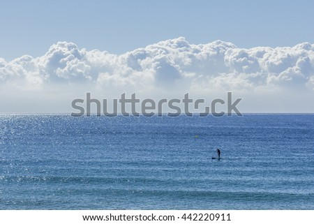 One man doing paddle surf at Barcelona, Spain