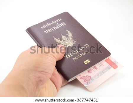 One man hold Thailand passport and Thai banknote in him left hand on white background
