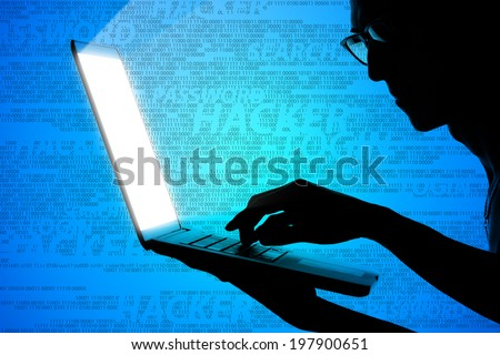 one man holding labtop ,Hacker - stock photo