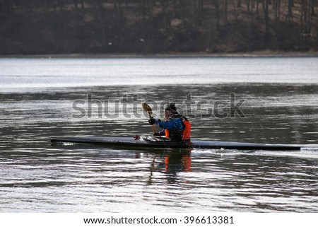One man in a ocean kayak in the sea, closeup and in Denmark - stock photo