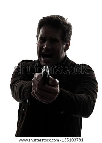 one man killer policeman aiming gun silhouette studio white background - stock photo
