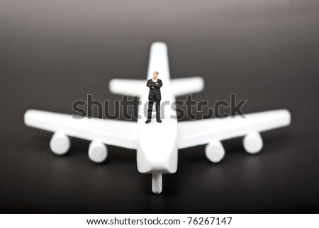 one man on plane on black - stock photo