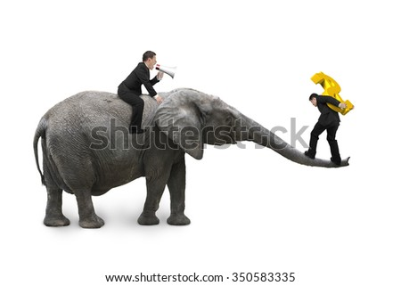 One man riding elephant using speaker to direct another man carrying golden dollar sign balancing on elephant trunk, isolated on white background.