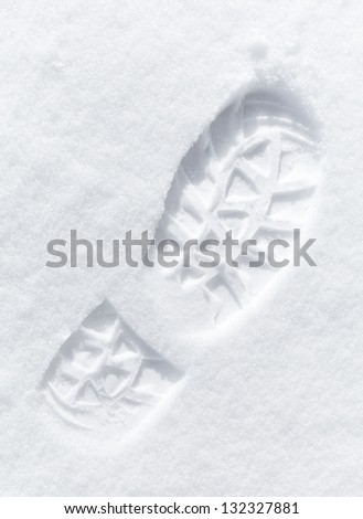 One man's footstep on the fresh friable snow - stock photo