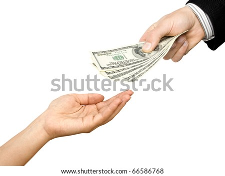 One man's hand gives dollars to other hand - stock photo