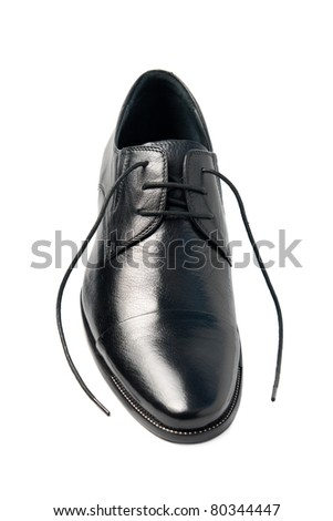 One man's shoes, with laces untied. Isolated on a white background - stock photo