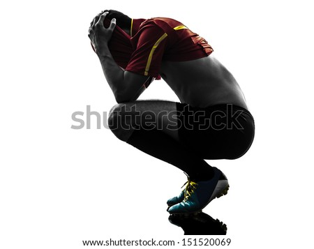 one man soccer player  loosing despair playing football competition in silhouette  on white background - stock photo