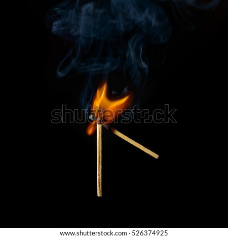 one match ignites another on a black background