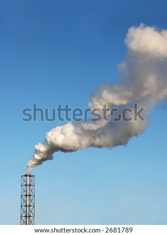 One metal chimney and smokestack against the blue sky
