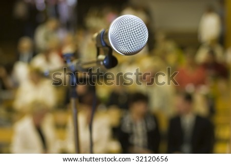 One microfone,  background the audience. - stock photo