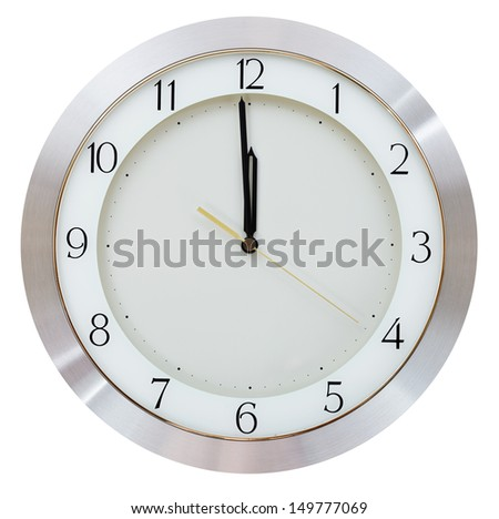 one minute to twelve o clock on the dial round wall clock - stock photo