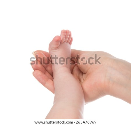 One month new born child baby foot leg in mother hand isolated on a white background