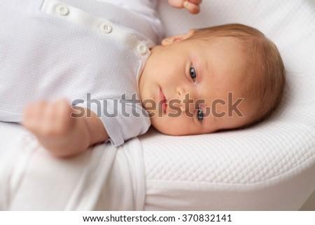 One month old newborn baby - stock photo