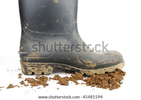 one muddy farmer boot and soil isolated on a white background - stock photo