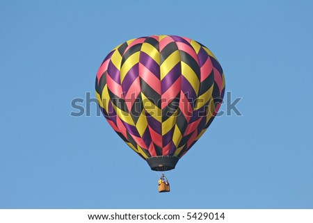one multi-colored hot air balloon in the sky