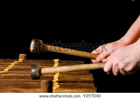 one musician playing xylophone in a studio - stock photo