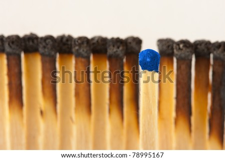 One new and group of burned matches - stock photo