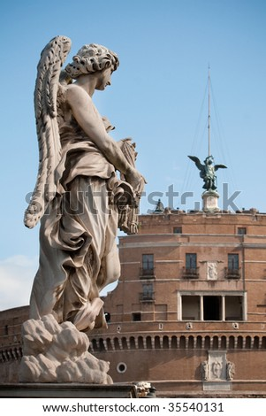 One of Bernini`s statue of angels (Angel with garment and dice) on Ponte Sant`Angelo, in front of Castel Sant`Angelo in Rome - stock photo