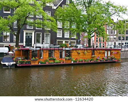 One of canal in Amsterdam, house on the water - stock photo