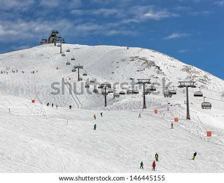 One of chair lifts in a ski resort of a valley of the Zillertal in foggy weather - Mayrhofen, Austria - stock photo
