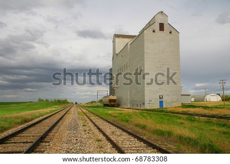 One of few remaining wooden prairie grain elevators on the Canadian prairies.  This iconic prairie sentinel is at Mossbank Saskatchewan - stock photo