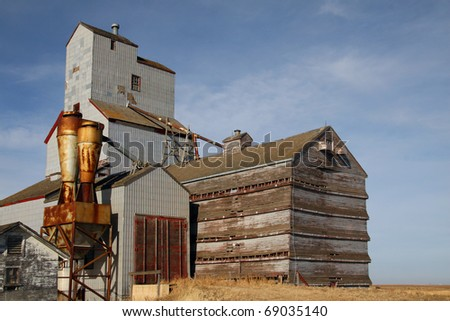 One of few remaining wooden prairie grain elevators on the Canadian prairies. This iconic prairie sentinel is abandoned at Bromhead Saskatchewan - stock photo