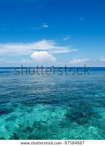 One of many Islands in Maldives where only clear water and  untouched coral reefs exits - stock photo