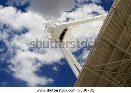 One of 27 radio antennas located at the Very Large Array, part of the National Radio Astronomy site west of Socorro, New Mexico.  Each antenna weighs about 230 tons and measures 82 feet in diameter. - stock photo