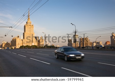 One of seven famous Stalin skyscrapers Hotel Ukraina (Radisson now) and Moscow-City from Novoarbatsky Bridge in early morning - stock photo