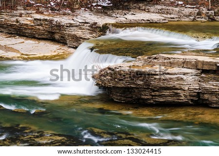 One of several small drops before the big plunge over Indiana's Upper Cataract Falls - stock photo