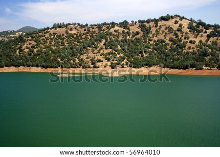 One of several small lakes along the foothills of the Sierra Nevada - stock photo