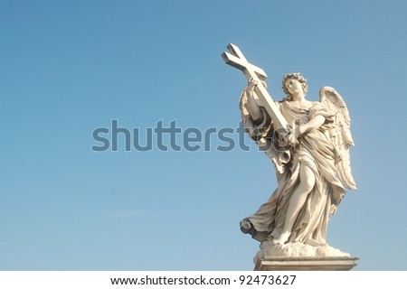 One of the angel statues on the famous Ponte Sant' Angelo bridge in Rome, Italy. Baroque sculpture by Ercole Ferrata.