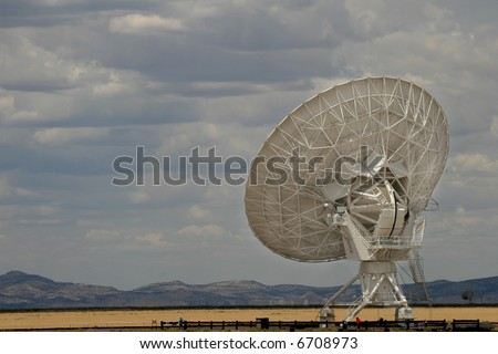 One of the antennae listening to the universe at the Very Large Array in New Mexico. - stock photo