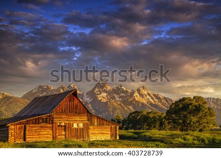 One of the barns at Mormon Row in Wyoming's Grand Teton National Park at sunrise