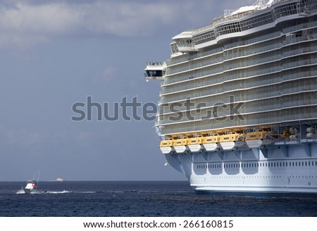 One of the biggest cruise ships in the world docked in Cozumel island (Mexico). - stock photo