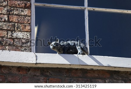 One of the decorative cat statues that are placed on numerous buildings in York, England.