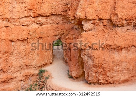 One of the doorway arches carved into the stone along the Queens Garden Trail in Bryce Canyon National Park.  - stock photo